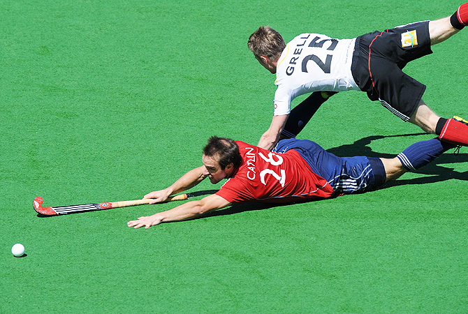 Nick Catlin of England (L) collides with Niklas Grell of Germany.