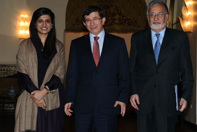From left to right, Foreign ministers Hina Rabbani Khar of Pakistan, Ahmet Davutoglu of Turkey and Zalmai Rassoul of Afghanistan pose for cameras before their meeting in Ankara, Turkey.