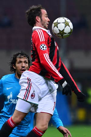 FC Zenith's Portuguese defender Bruno Alves (back) fights for the ball with AC Milan's forward Giampaolo Pazzini during the Champions League match AC Milan vs  FC Zenith at the San Siro Stadium in Milan.