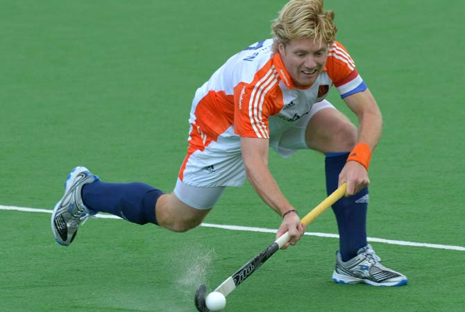 Netherlands players celebrate a goal against Belgium during their Pool B match at the Men's Hockey Champions Trophy tournament in Melbourne on December 4, 2012.