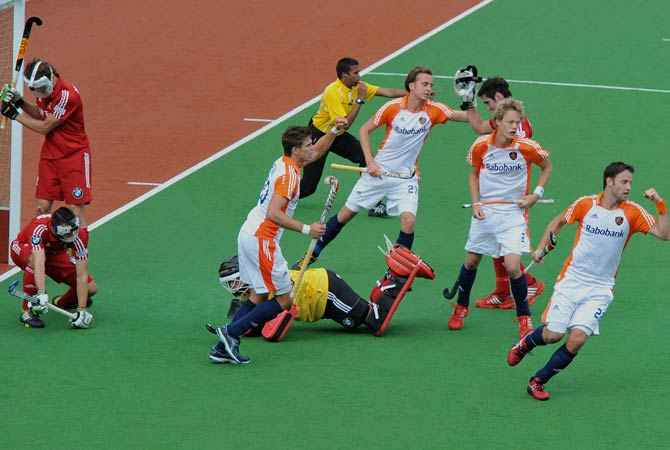 Xavier Reckinger of Belgium (Right) fires a shot at goal keeper Pirim Blaak of the Netherlands during a penalty corner at the end of the first half during their Pool B match at the Men's Hockey Champions Trophy tournament in Melbourne on December 4, 2012. The Nehterlands was leading 3-0 at half-time.
