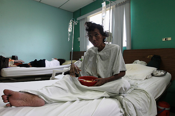Karla Hernandez, an HIV-positive patient, rests on a bed at the Hospital Manolo Morales in Managua November 30, 2012. ? Photo by Reuters