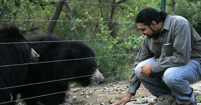 This file photograph taken on February 19, 2007 shows co-founder of Wildlife SOS Kartick Satyanarayan interacting with rescued bears at the Agra Bear Rescue Centre on the outskirts of Agra in the northern Indian state of Uttar Pradesh.—AFP (File Photo)