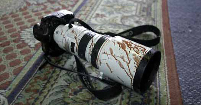 camera-with-blood-smeared-on-it670
