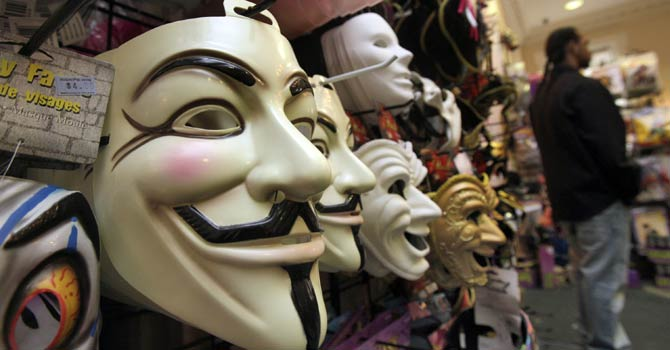 "In this Oct 21, 2011 file photo, masks, including ""V for Vendetta,"" left, are displayed at a Ricky's Halloween store in New York. - AP Photo"