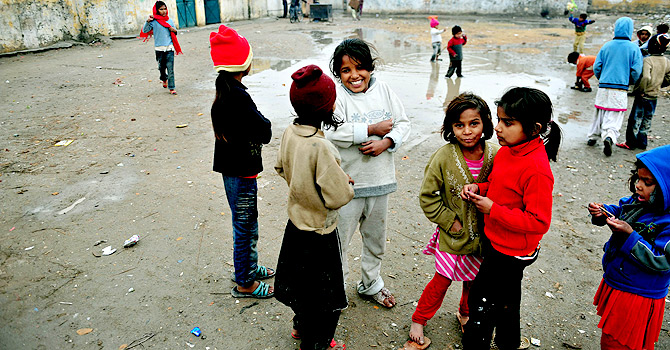Pakistani Christian children play outside their homes in the run-down area of Mehrabad on the outskirts of Islamabad.
