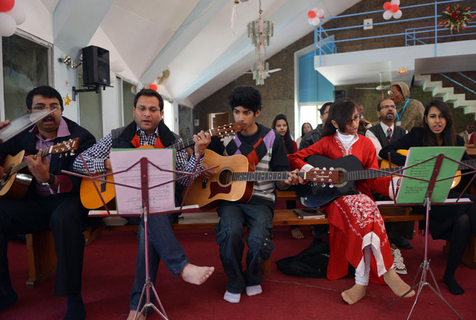 Pakistani Christians sing hymns during Christmas mass at the Fatima Church in Islamabad on December 25, 2012.