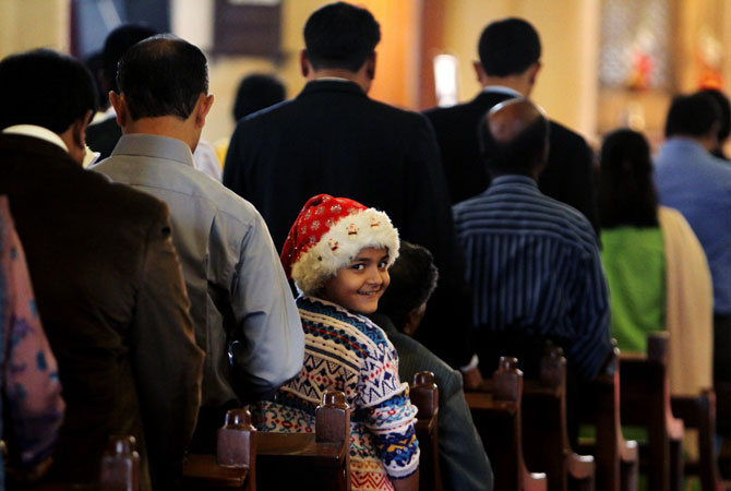 People attend Christmas service at a local church in Karachi, Pakistan, Tuesday, Dec. 25, 2012.