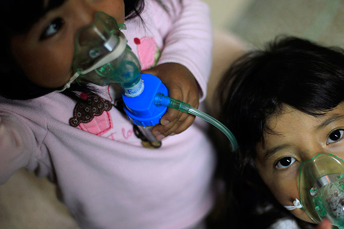 Children receive inhalotherapy in the San Jose Hospice, in Sacatepequez, 45 km (28 miles) of Guatemala City, November 30, 2012. About 68 HIV-infected children receive free medical care at the hospice, many of them were found abandoned in markets, churches, fire stations, left neglected in hospitals or in some instances, brought in by their families who cannot afford to pay for their medical treatment. ? Photo by Reuters