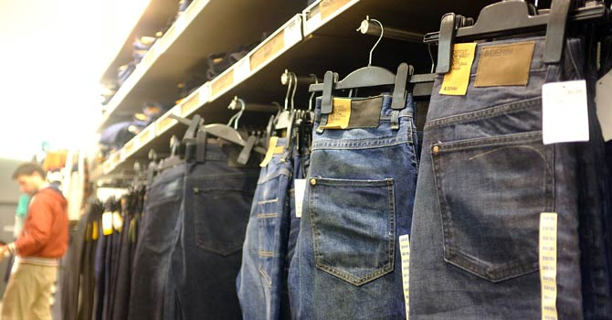 Low cost jeans are displayed at a discount clothing store on November 28, 2012 in New York City. Following a fire at Tazreen Fashions Ltd. factory in Bangladesh in which 112 workers were killed on November 24, renewed scrutiny has been brought upon Western clothing companies and their responsibility for working conditions at their overseas operations. Wal-Mart's Faded Glory brand, Sean Combs' ENYCE label and apparel from the Disney Store are just some of the Western brands that were sewn at the Bangladeshi factory. As American consumers continue to demand bargain prices for clothes, retailers are under increasing pressure to balance safe working conditions with cheap labour costs.– Photo by AFP
