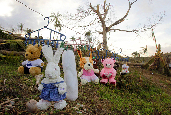 Residents hang their teddy bears and other stuffed toys out to dry on a clothesline in the coastal town of Boston which was devastated by Typhoon Bopha last Tuesday, in Davao Oriental, southern Philippines December 10, 2012. Typhoon Bopha killed 647 people and caused crop damage worth 8.5 billion pesos ($210 million). The most intense storm to hit the Philippines this year wiped out about 90 per cent of three coastal towns in Davao Oriental province and buried an entire town in neighbouring Compostela Valley provin