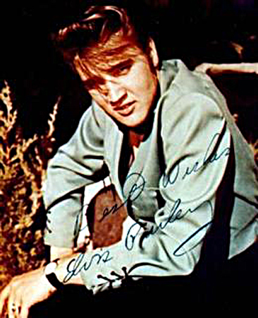 Singer Elvis Presley is pictured in this undated publicity photograph which is autographed. — Reuters Photo