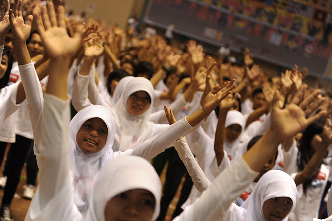"Hundreds of Indonesian youths participate in the ""Dance 4 Life"" as part of social awareness campaign against HIV/AIDS in celebration of the World AIDS Day in Jakarta. The southeast Asian nation"