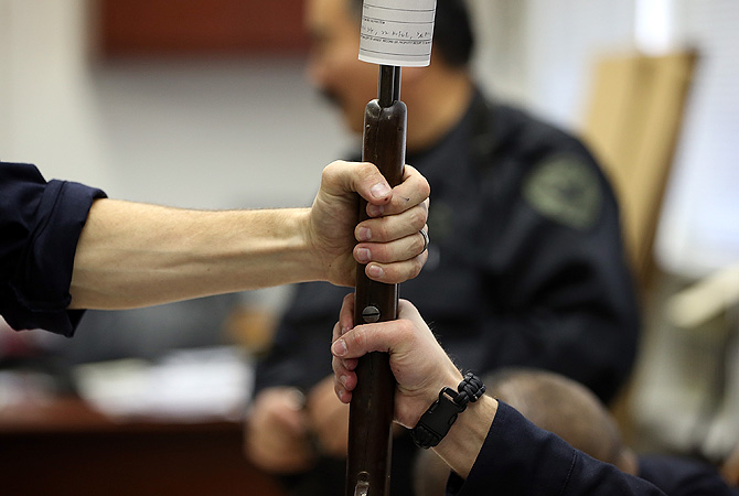 San Francisco police officers document guns that are being surrendered during a gun buy back program in San Francisco, California. The San Francisco police department held a one-day gun buy back event that paid $200 per gun turned in.?Photo by AFP
