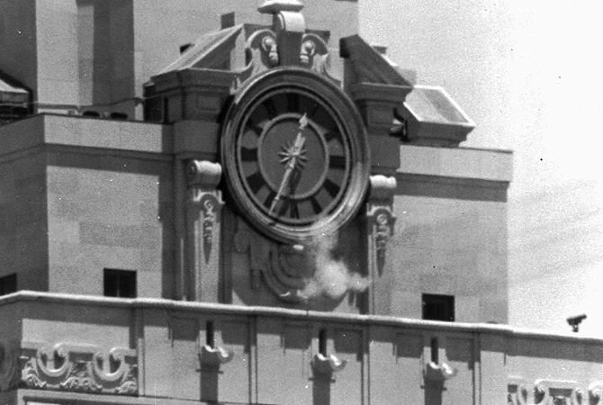 "In this Aug. 1, 1966 file photo, smoke rises from a sniper's gun as he fires from the tower of the University of Texas administration building in Austin, Texas at people below. Grant Duwe, a criminologist with the Minnesota Department of Corrections, says, ""Mass shootings provoke instant debates about violence and guns and mental health and that's been the case since Charles Whitman climbed the tower at the University of Texas in 1966.""?Photo by AP"