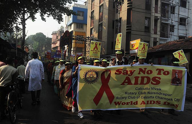 Indian volunteers and members of a social organisation holds placards with HIV/AIDS awareness messages during a rally to celebrate World AIDS Day in Kolkata. The UNAIDS agency says some 2.5 million Indians are living with HIV, many of them ostracized by their communities. ? Photo by AFP