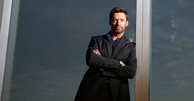 Actor Hugh Jackman poses for a portrait while promoting his movie Les Miserables in New York, November 30, 2012.    REUTERS/Carlo Allegri  (UNITED STATES - Tags: ENTERTAINMENT PROFILE)