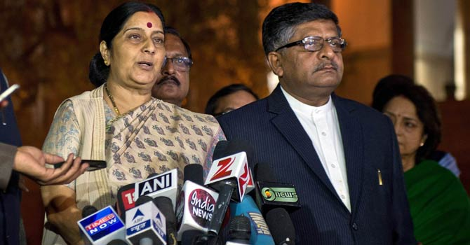 Leader of Opposition of Lok Sabha (Lower House ) and Bhartiya Janata Party Leader Sushma Swaraj (L) addresses the media as colleague Ravi Shakar Prasad (R) looks on at Parliament House during the winter session in New Delhi on Dec 5, 2012. - AFP Photo