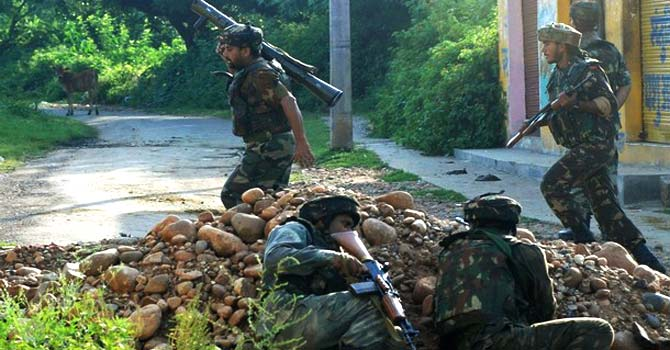 Indian army soldiers run at an encounter site in Kashmir. – File photo by Reuters