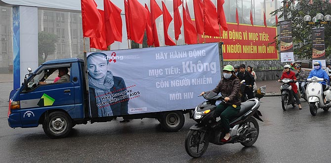 A truck carries a poster advertising World's AIDS Day in Hanoi. Since the first HIV case detected in 1990, the number of cases is projected to be 280,000 or 0.47 percent of the Vietnamese population in 2012 with injecting drug users (IDU) accounting for up to 65 percent of people living with HIV. ? Photo by AFP