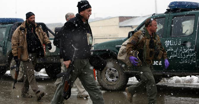 Foreign contractors arrive at the site of a blast in Kabul Dec 17, 2012. A bombing in the Afghan capital Kabul killed one person and wounded 15 on Monday, Kabul's police chief said. - Reuters