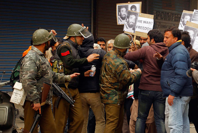 Indian police detain Chief of Jammu Kashmir Liberation Front (JKLF) Yasin Malik, who is carrying a placard reading ?We want freedom?, and his supporters in Srinagar December 7, 2012.