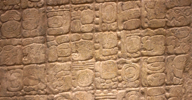 This Dec. 14, 2012 photo shows a detail of a replica of the Sixth Monument, which mentions the 13th Baktun, the end of a major 5,125-year cycle in the Mayan Long Count calendar, on display at the Mayan Museum in Cancun. Amid a worldwide frenzy of advertisers and new-agers preparing for a Maya apocalypse, one group is approaching Dec. 21 with calm and equanimity calm _ the people whose ancestors supposedly made the prediction in the first place. Mexico's 800,000 Mayas are not the sinister, secretive, apocalypse-obsessed race they've been made out to be. - Photo by AP