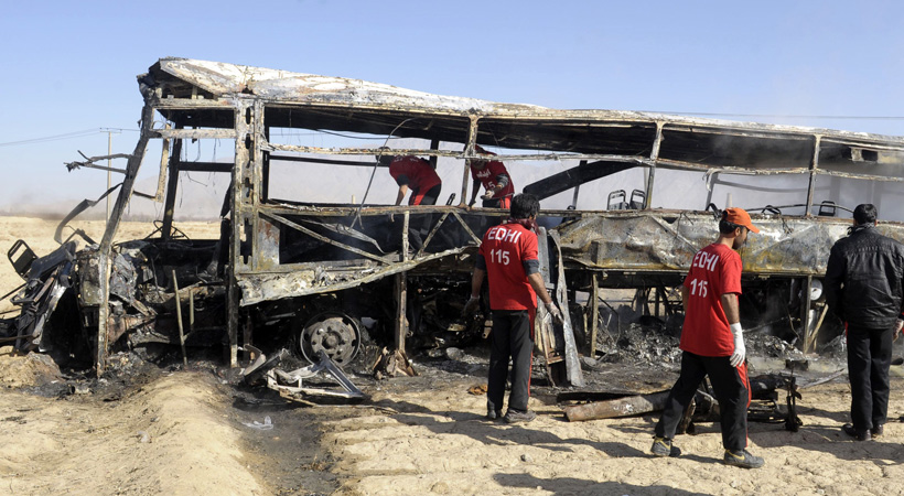 Pakistani volunteers search for victims in a destroyed pilgrims bus at the site of a car bomb attack in Mastung some 30 kilometres south of Quetta. A car bomb attack on buses carrying Shiite Muslim pilgrims to Iran has killed 19 people and injured 25 in Pakistan's insurgency-hit southwest on December 30, officials said.?Photo by AFP