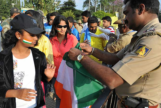 Cricket fans undergo security checks before entering The M. Chinnaswamy Stadium in Bangalore. -Photo by AFP
