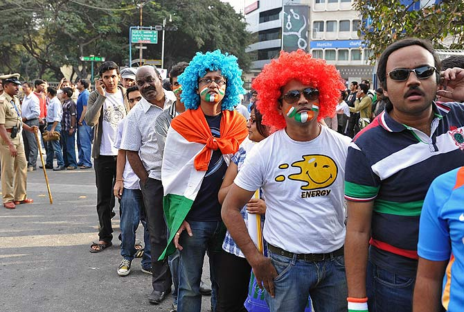 Fans line up outside the stadium in Bangalore. -Photo by AFP