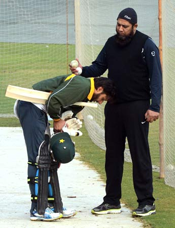 Shahid Afridi and Inzamam-ul-Haq during a batting session in the nets. ? Photo by AFP