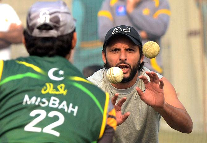 Shahid Afridi and MIsbah-ul-Haq in a give-and-take fielding session. ? Photo by AFP