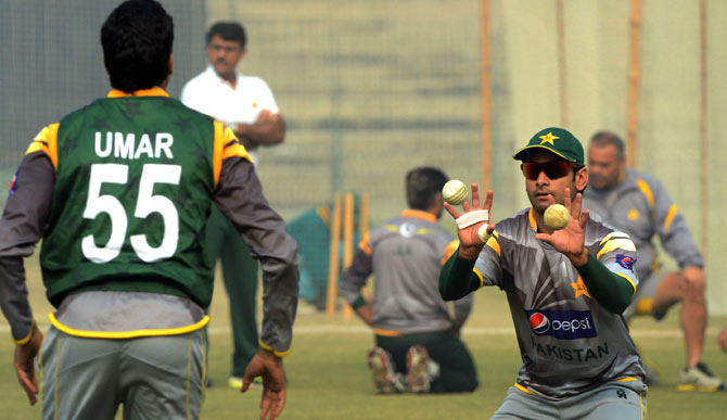Mohammad Hafeez and Umar Gul take part in fielding practice. ? Photo by AFP
