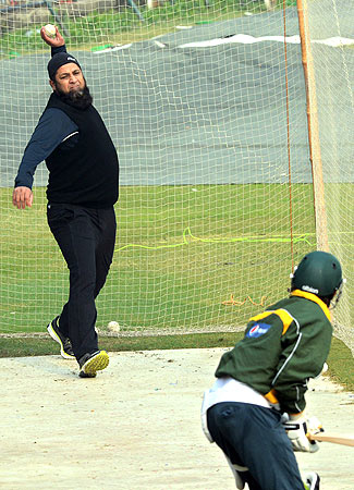 Inzamam-ul-Haq bowls to  batsman in the nets. ? Photo by AFP