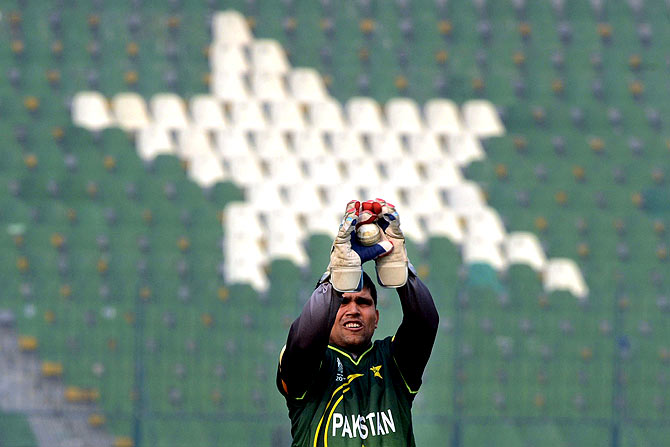 Pakistan's wicketkeeper Kamran Akmal catches a ball during practice. ? Photo by AFP