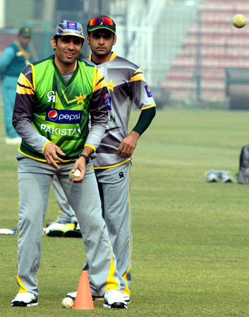 Pakistan's ODI and T20 captains Misbah-ul-Haq and Mohammad Hafeez take part in fielding practice. ? Photo by AFP