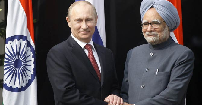 Russian President Vladimir Putin, left, shakes hands with Indian Prime Minister Manmohan Singh, right, before a meeting at his residence in New Delhi, India, Monday, Dec 24, 2012. - AP Photo