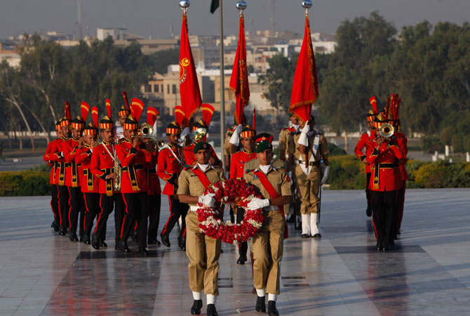 Cadets from Pakistan Air Force walk to lay a floral wreath during a guard mounting ceremony at the mausoleum of Mohammad Ali Jinnah, in Karachi December 25, 2012. A contingent of PMA cadets mounted the guard at the mausoleum of Mohammad Ali Jinnah to mark his 136th birth anniversary.