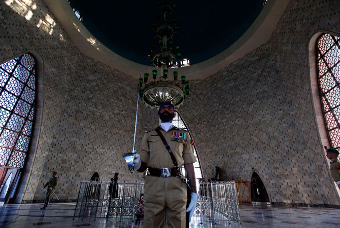 An officer from Pakistan Military Academy (PMA) holds his sword while he stands in the mausoleum of Mohammad Ali Jinnah during the guard mounting ceremony in Karachi December 25, 2012. A contingent of PMA cadets mounted the guard at the mausoleum of Mohammad Ali Jinnah to mark his 136th birth anniversary.