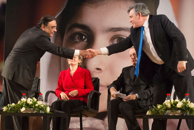 Pakistan's President Ali Zardari, left, shakes hands with former British Prime Minister Gordon Brown, right, while Secretary-General,Irina Bokova, France's Prime Minister, and Jean-Marc Ayrault, sit in the background at a ceremony at Unesco headquarters in Paris, Monday, Dec. 10, 2012, to honor 15-year-old schoolgirl Malala Yousafzai, who was shot in the head by a Taliban gunman, in the northwest Swat Valley in Pakistan on Oct. 9, 2012.