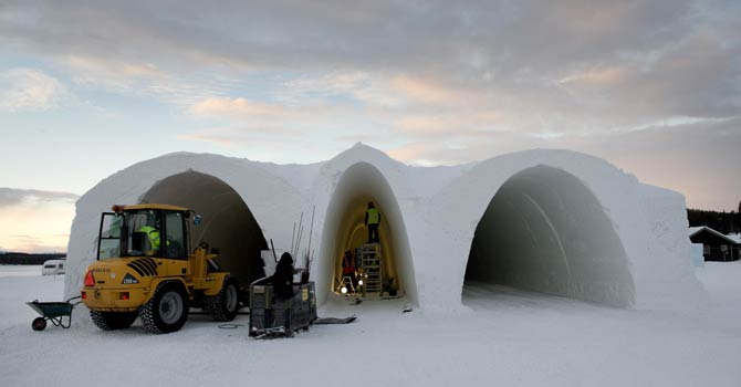 People work at the construction site of the new Ice Hotel in the village of Jukkasjarvi, near Kiruna, in Swedish Lapland on Nov 16, 2012. The Ice Hotel gets a new design and is reconstructed every year, and is dependent upon constant sub-freezing temperatures during construction and operation. - AFP Photo