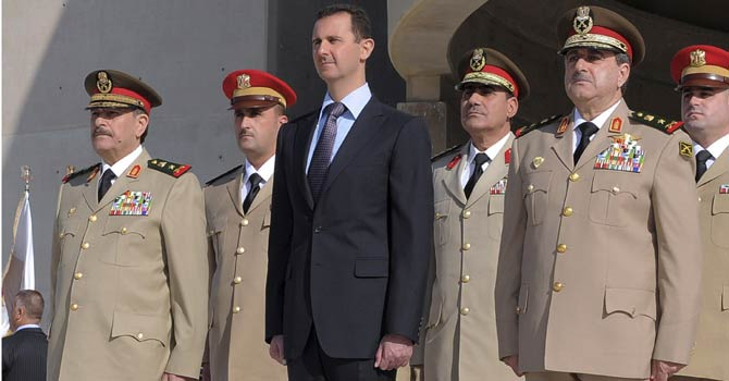 In this Thursday, Oct 26, 2011 file photo released by the Syrian official news agency SANA, Syrian President Bashar Assad, center, stands next to Syrian Defense Minister Gen. Dawoud Rajha, right, and Chief of Staff Gen. Fahed al-Jasem el-Freij, left, during a ceremony to mark the 38th anniversary of the October 1973 Arab-Israeli war, in Damascus, Syria. - AP File Photo