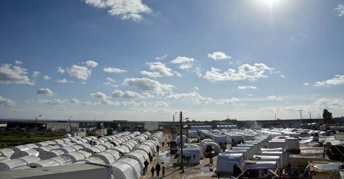 Rows of makeshift accomodation are seen in a refugee camp on the border between Syria and Turkey near the northern city of Azaz on Dec 5, 2012. The internally displaced faced further misery as heavy rain was followed by a drop in temperatures. The United Nations estimated late October that more than 2.5 million people have been affected by the fighting in Syria. There are more than 348,000 Syrian refugees registered in neighbouring countries, but many more are unregistered.  - AFP Photo