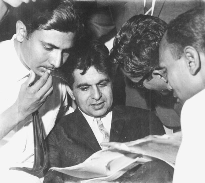 The writer showing Dilip Kumar the cover story on him. - File photo courtesy author