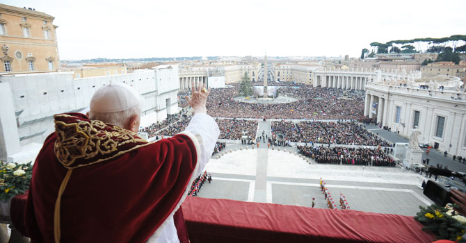 "In this photo provided by Vatican paper L'Osservatore Romano, Pope Benedict XVI delivers his ""Urbi et Orbi"" (to the City and to the World) message from the central balcony of St. Peter's Basilica, at the Vatican, Tuesday, Dec. 25, 2012. Pope Benedict XVI wished Christmas peace to the world, decrying the slaughter of the ""defenseless"" in Syria and urging Israelis and Palestinians to find the courage to negotiate. Delivering the Vatican's traditional Christmas day message from the central balcony of St. Peter's Basilica, a weary-looking and hoarse-sounding Benedict on Tuesday also encouraged Arab spring nations, especially Egypt, to build just and respectful societies. - Photo by AP"