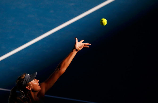 Maria Sharapova of Russia serves to compatriot Ekaterina Makarova during their women's singles quarter-final match at the Australian Open tennis tournament in Melbourne January 22, 2013. – Photo by Reuters