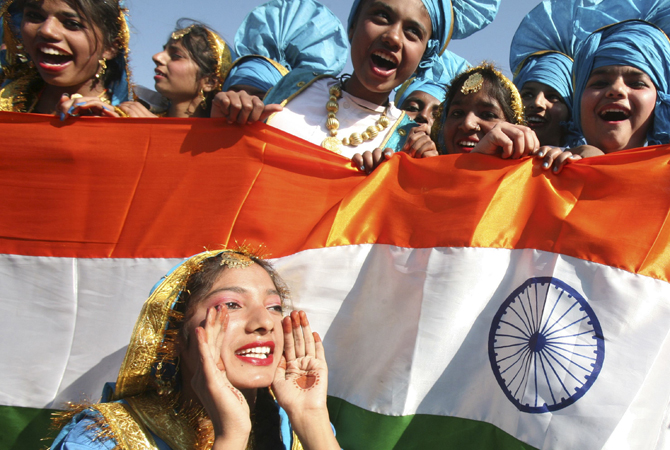 School children cheer after performing at a cultural program during the Republic Day celebrations in the northern Indian city of Chandigarh January 26, 2013.