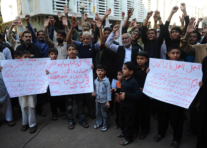 People chant slogans during a protest rally in Karachi on January 11, 2013, against the bomb attacks in Quetta. Extremist bomb attacks killed 125 people in one of Pakistan's deadliest days for years, raising concerns about rising violence in the nuclear-armed country ahead of general elections. – Photo by AFP