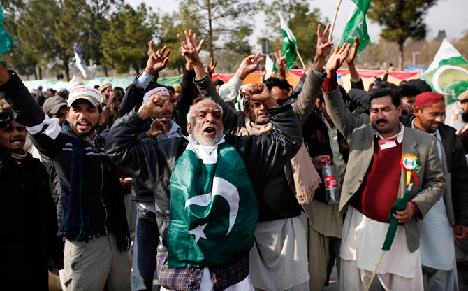 Supporters of Muhammad Tahirul Qadri, shout slogans during a protest in Islamabad January 14, 2013. Thousands of Pakistanis converged on the capital Monday to join a march planned by Qadri calling for the indefinite delay of elections and a crackdown on government corruption and inefficiency. ? Photo by Reuters