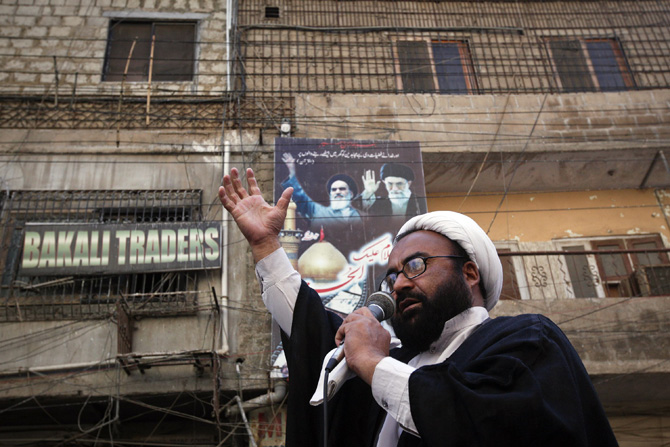 Shi'ite leader Mohammad Hussain Karimi addresses a protest rally organised by the religious group Majlis-e- Wahdat-e-Muslimeen (MWM) in Karachi, January 11, 2013, to condemn the bomb blasts in Quetta a day earlier, and the killings of Shiites.  – Photo by Reuters